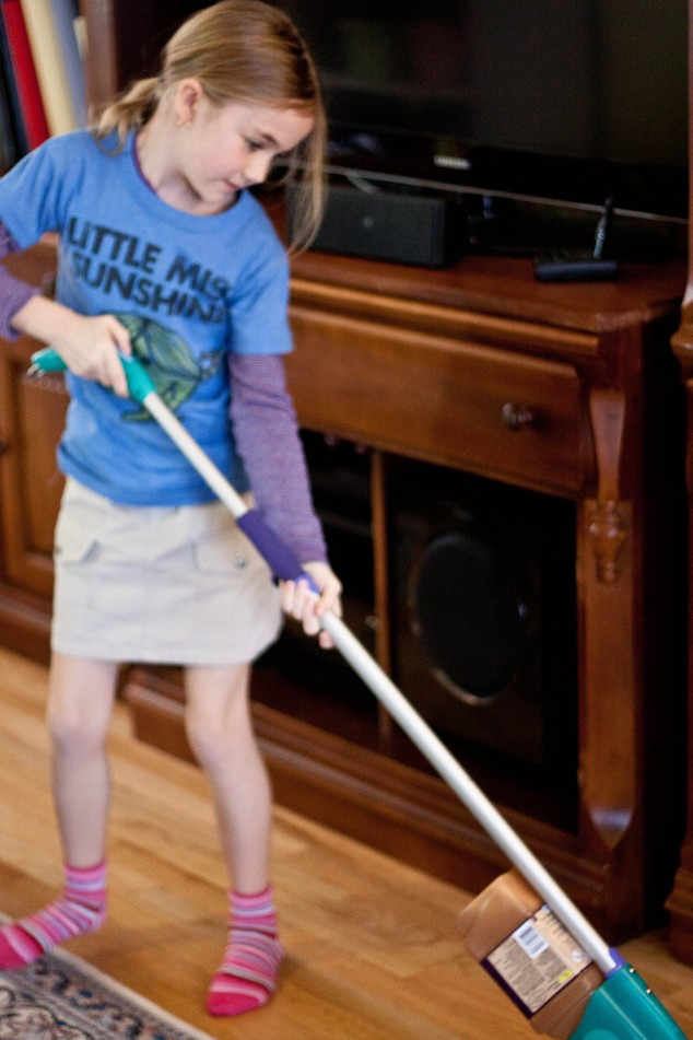 Young girl mopping
