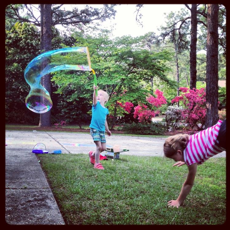 homeschool break, spring break, kids playing in yard Not So SAHM