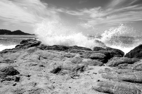 waves crash against the rocks at Carmel River State Beach