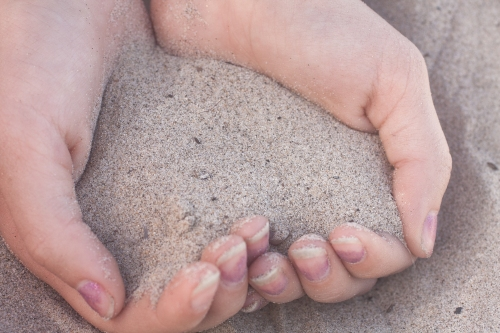 California beach sand cupped in hands Not So SAHM