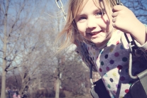 Girl swings on a sunny day in winter NotSoSAHM
