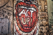 A piece of the Berlin Wall on exhibit at the Newseum in Washington D.C. has an open mouth with the words ACT UP painted in the mouth NotSoSAHM