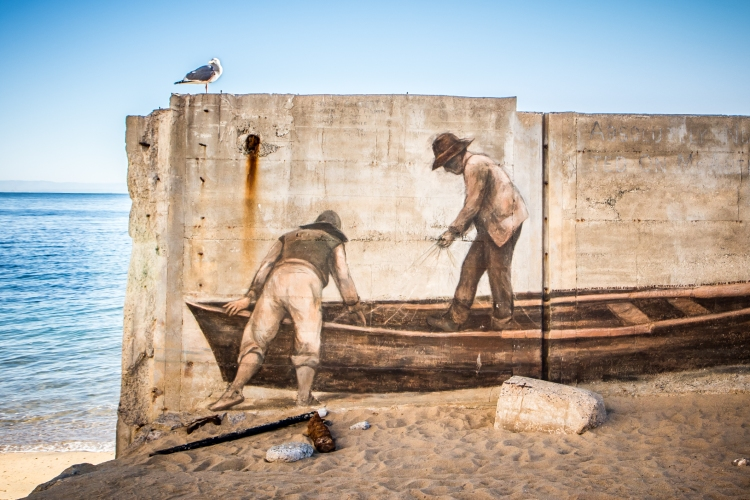A mural of two fishermen prepping their boat is painted on the sea wall in Monterey Bay NotSoSAHM