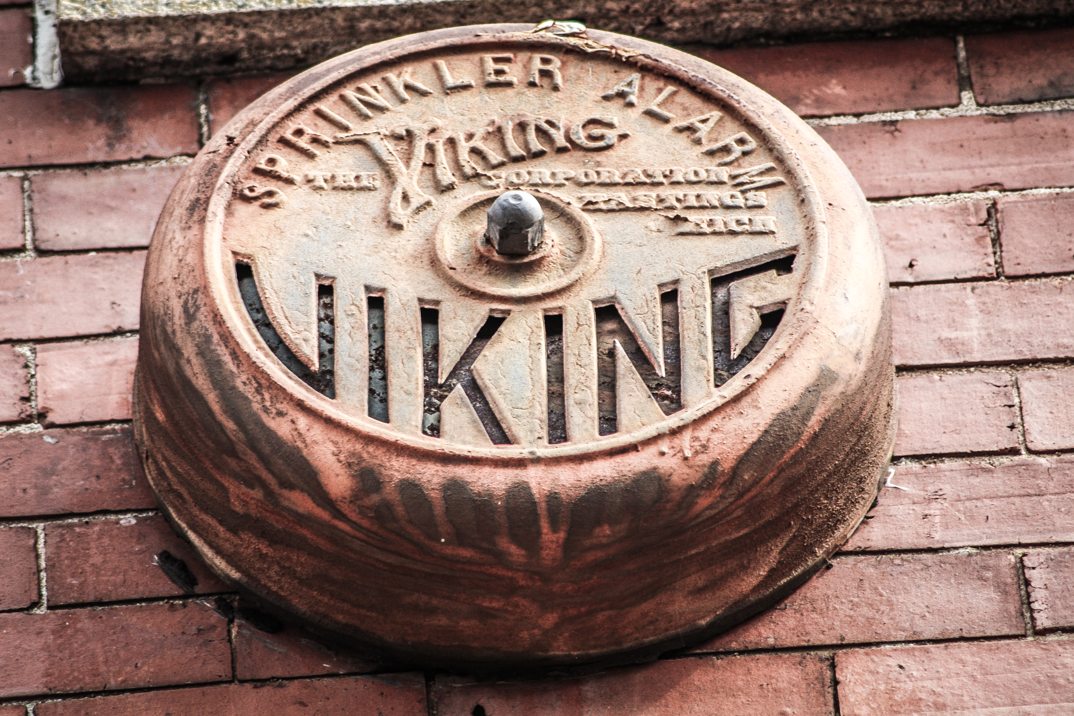 an old Viking Sprinkler Alarm is still attached to the side of a building in downtown Macon, GA NotSoSAHM
