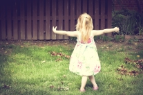 Girl dances in the grass on Easter NotSoSAHM