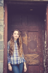 Girl stands in front of the door of the lock keeper's house in Washington DC NotSoSAHM