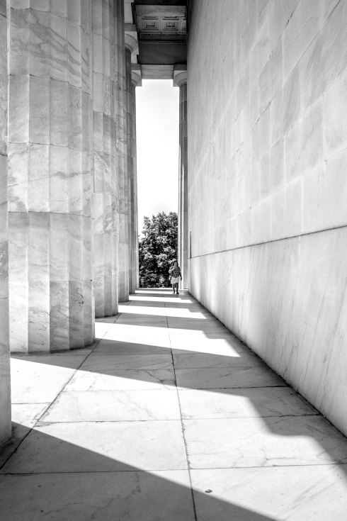 A woman walks down a corridor of tall columns at the Lincoln Memorial in Washington DC NotSoSAHM