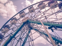 A ferris wheel circles with clouds in the background NotSoSAHM