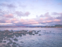 Heavy clouds reflect the pink setting sun in Lover's Point of Monterey Bay, CA NotSoSAHM