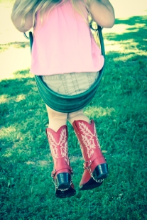 Girl on swing with red cowboy boots Not So SAHM