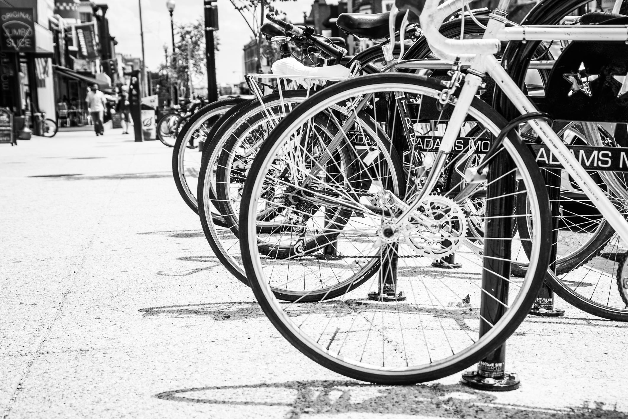 Bikes and pedestrians fill the sidewalks of Adams Morgan in Washington D.C. Not So SAHM