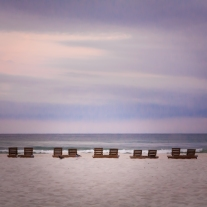 Pairs of wooden beach chairs line a Pensacola Beach Not So SAHM