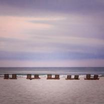 Pairs of wooden beach chairs line a Pensacola Beach Not So SAHM