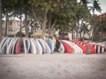 A man sets up surf boards for rent on Waikiki Beach on Oahu, Hawaii Not So SAHM