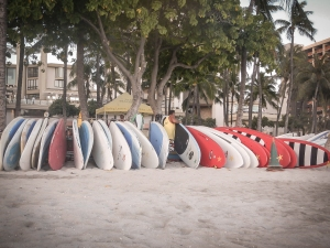 A man sets up surf boards for rent on Waikiki Beach on Oahu, Hawaii Not So SAHM