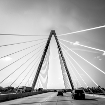 The cables surround you, driving over a suspension bridge in Kansas City Not So SAHM