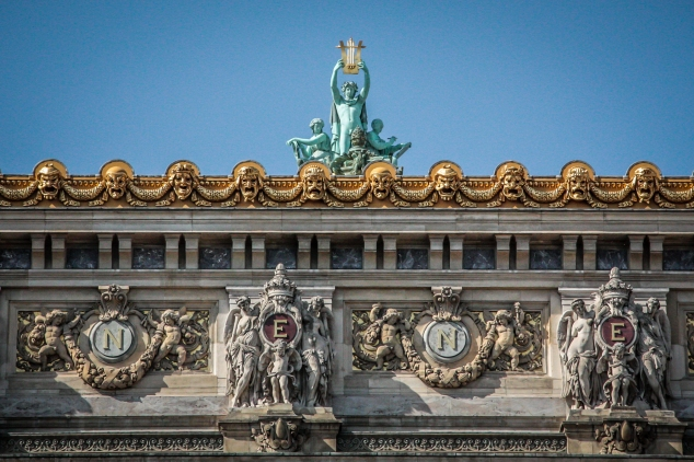 The facade of the Opera building in Paris is opulent with statues and gilding. Not So SAHM