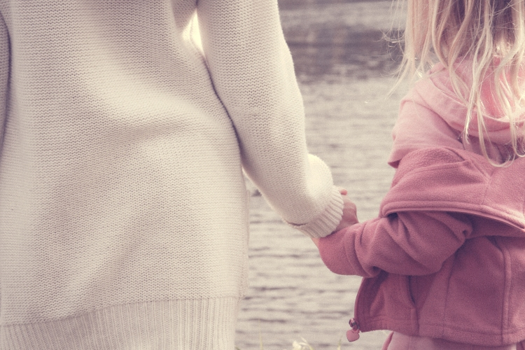 Two sisters hold hands by a river. Not So SAHM