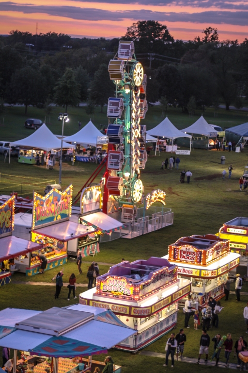 Food booths and rides at the county fair. Not So SAHM