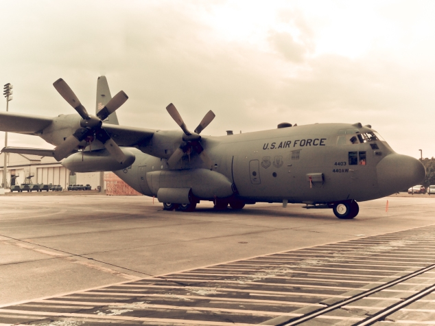 A C-130 Hercules sits near a runway. Not So SAHM