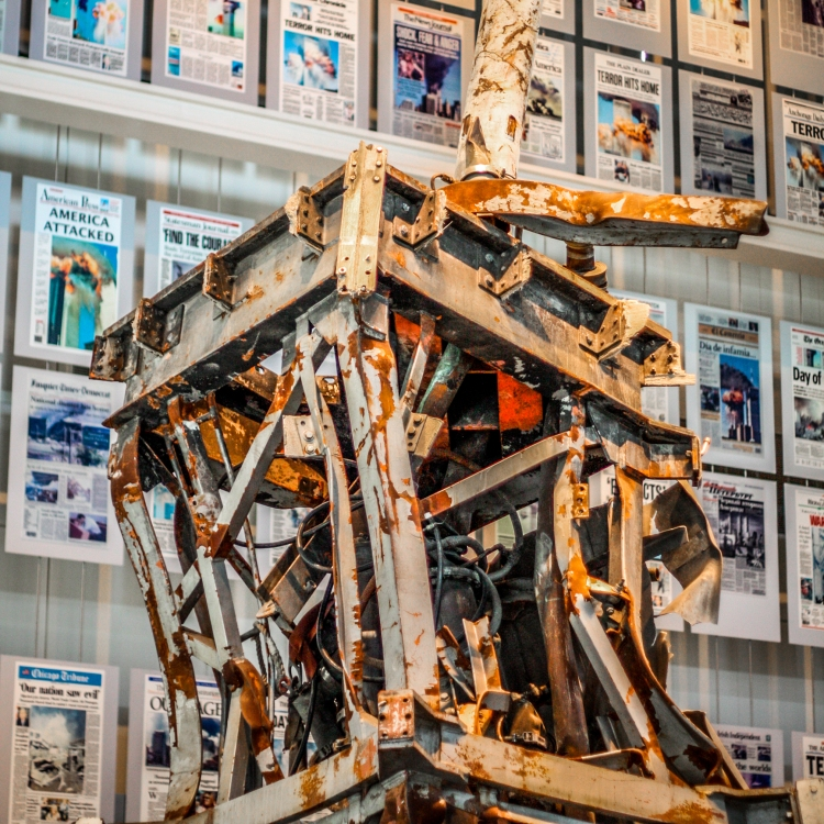 A piece of the steel structure of the World Trade Center is on display at the Newseum in front of various front pages of papers that detail the terrorism of 11 September 2001. Not So SAHM