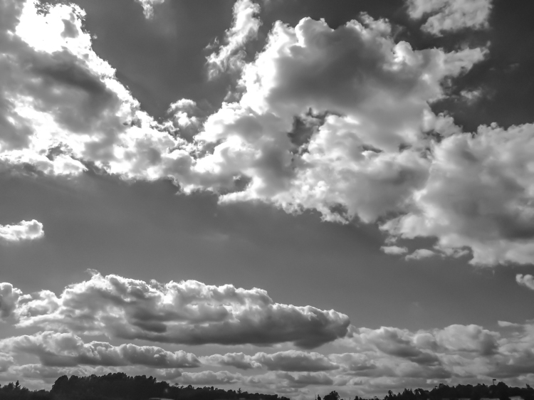 Fluffy, cotton-like clouds fill the sky. Not So SAHM
