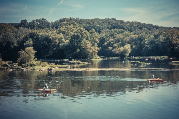 People float down the Potomac River in kayaks. Not So SAHM
