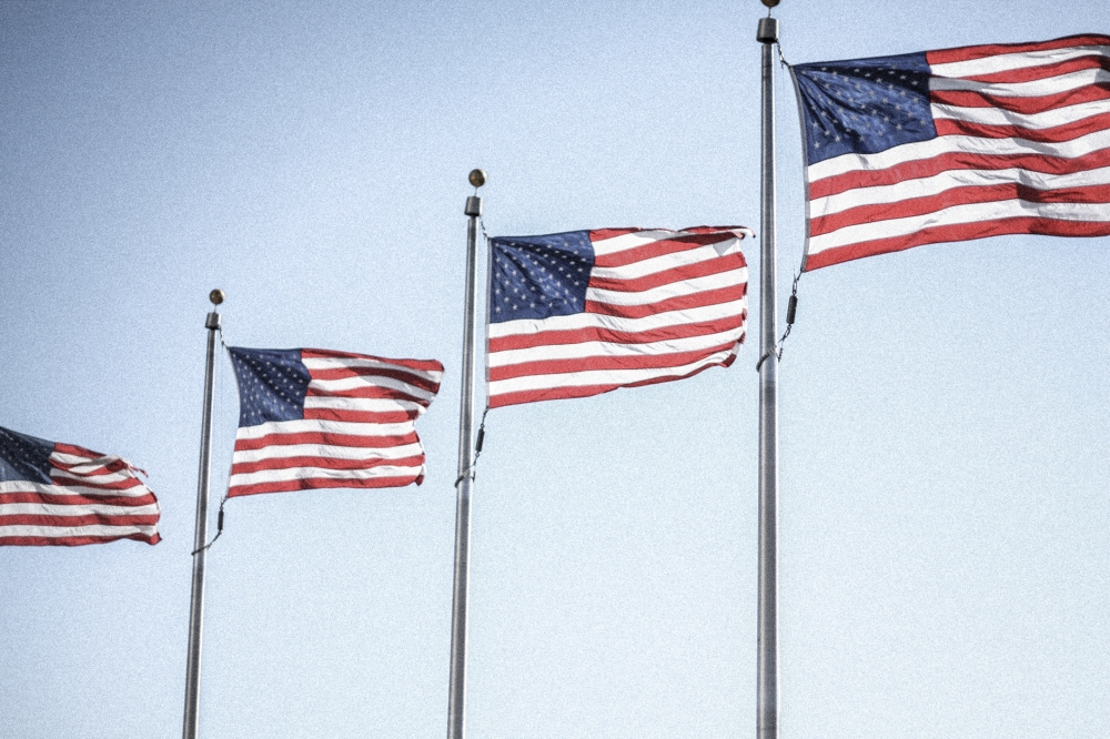 American flags wave in the breeze. Not So SAHM