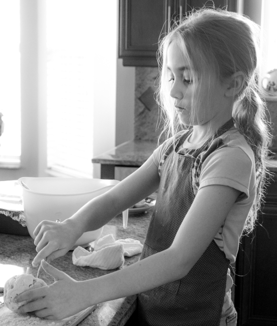 Girl works with salt dough in the kitchen. Not So SAHM
