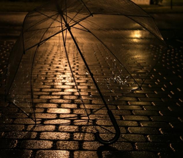 An umbrella sits forgotten on the pavement. Not So SAHM