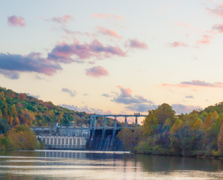 A dam sits nestled in the fall trees in Virginia. Not So SAHM