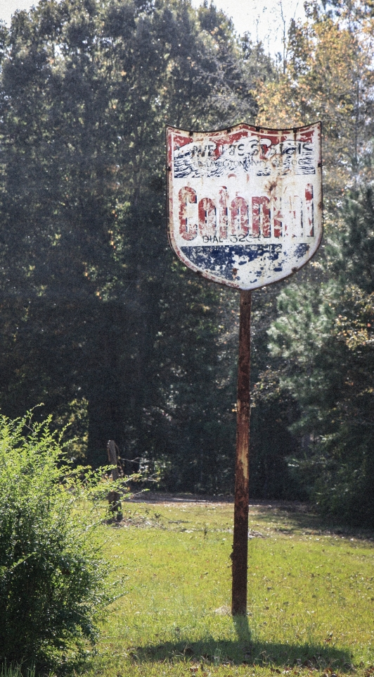 An old Colonial sign stands rusted along side a country road. Not So SAHM