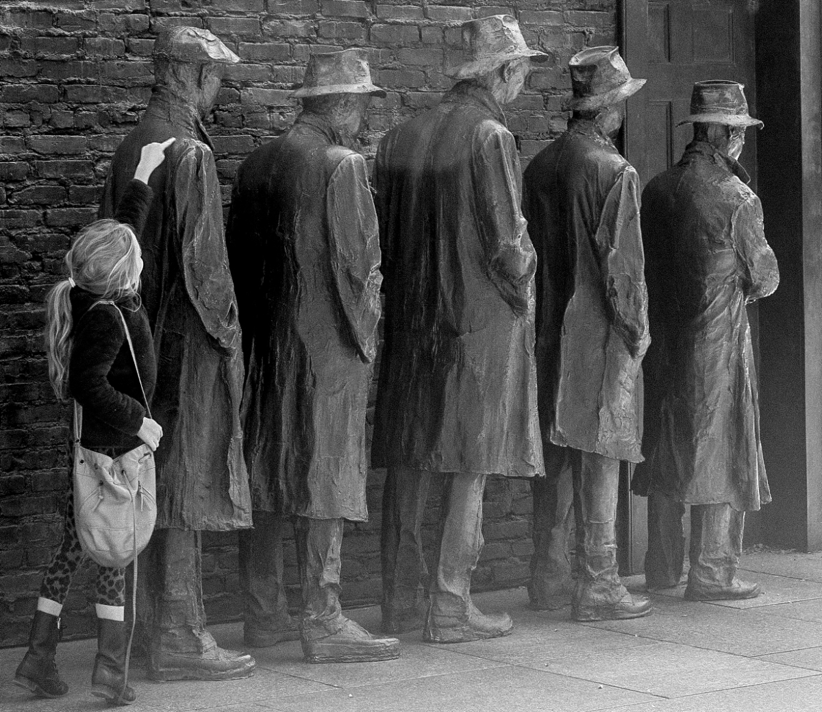 Girl stands in the back of statues waiting in a soup kitchen line at the FDR Memorial in Washington DC. Not So SAHM