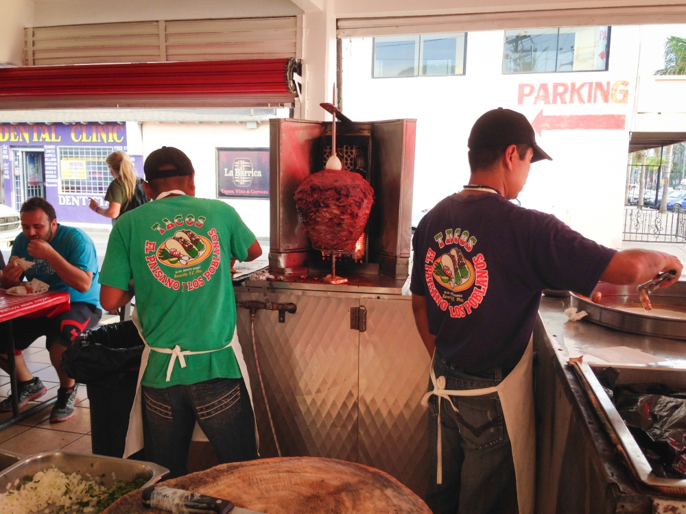 Two chefs fix tacos at a street corner open restaurant in Rosarito, Mexico. Not So SAHM