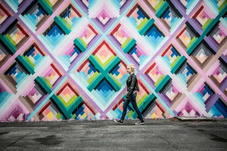 Teen walks by one of the graffiti walls in the Wynwood Walls neighborhood of Miami. Not So SAHM