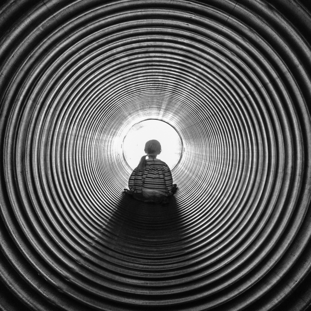 Girl slides down a hole that looks like the Twilight Zone. Not So SAHM