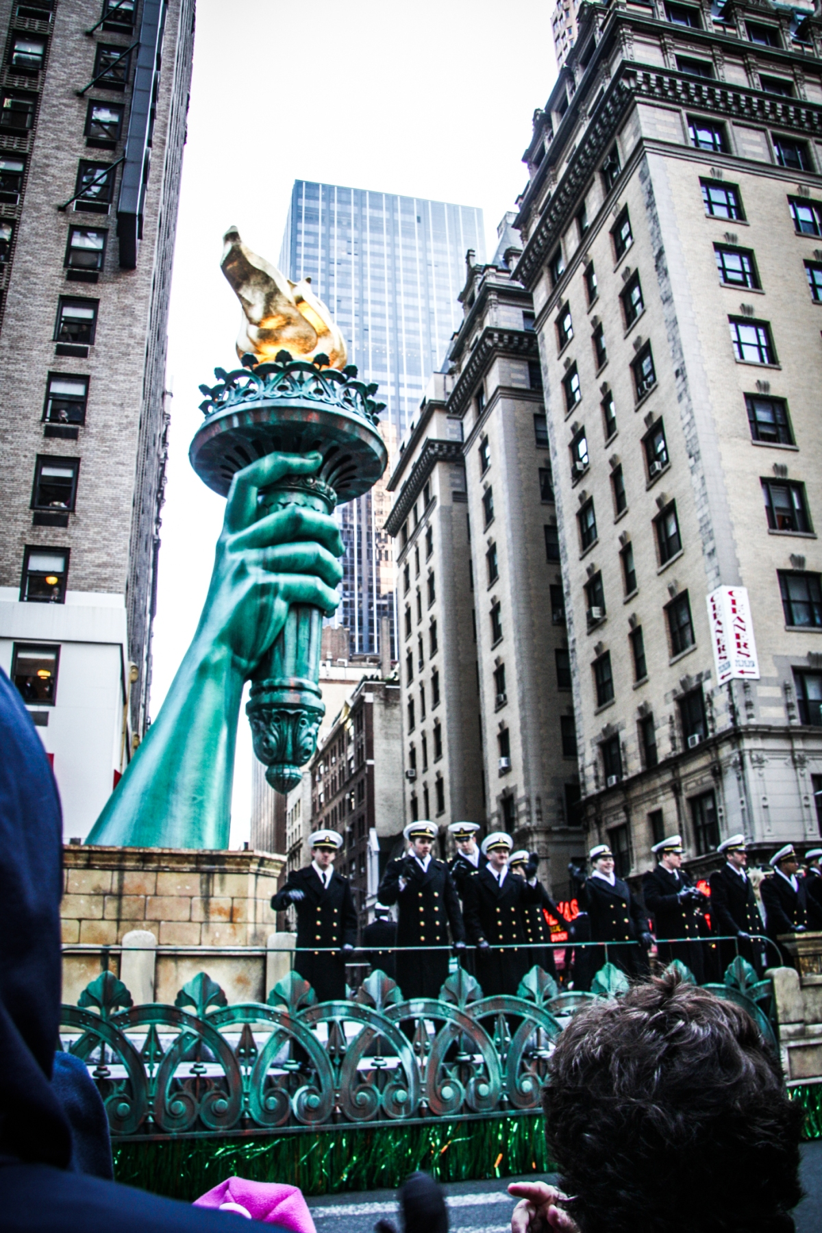 A parade float with the torch of the statue of liberty floats by in the macy's thanksgiving day parade. Not So SAHM