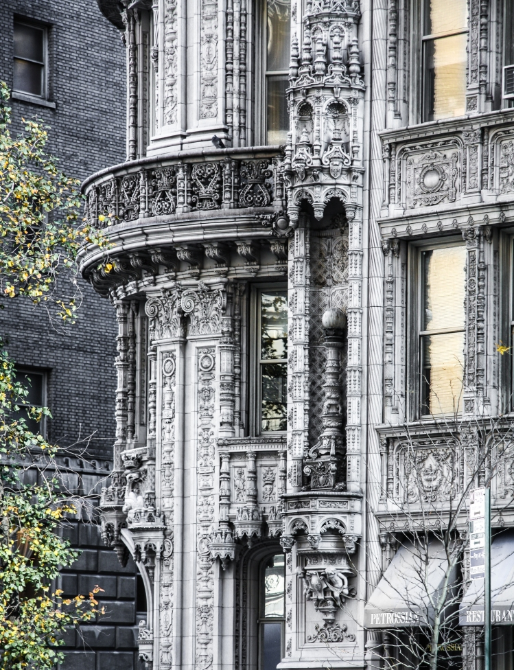 An intricately carved building, the Alwyn, stands in the midst of modernity in NYC. Not So SAHM