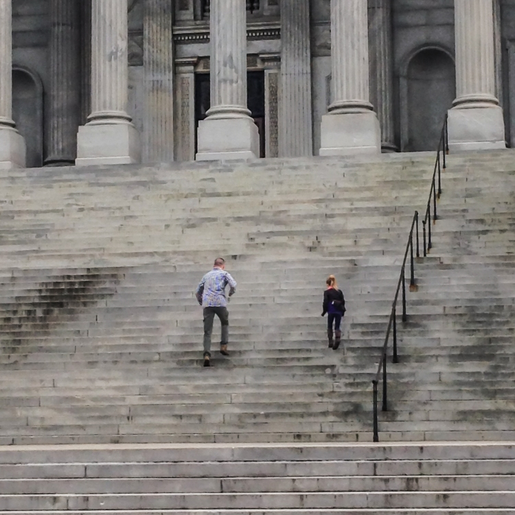 Dad and child race up state capitol steps. Not So SAHM