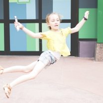 Girl jumps in the air. Photo by VSD Photography
